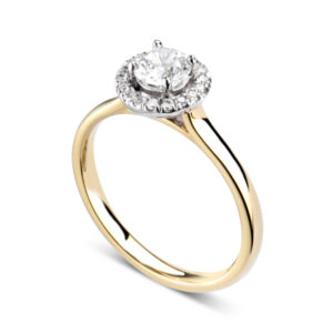 Éblouissante : Bague de fiançailles en or jaune 18k avec halo serti de diamants. Halo serti dressé 16 diamants G/VS total 0.07 carats.