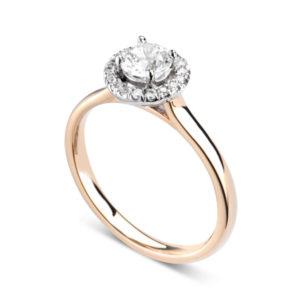 Éblouissante : Bague de fiançailles en or rose 18k avec halo serti de diamants. Halo serti dressé 16 diamants G/VS total 0.07 carats.
