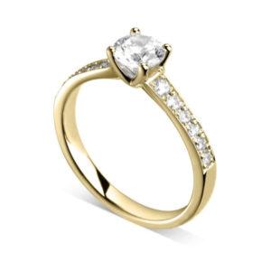 Luxueuse : Bague de fiançailles en or jaune 18k aux épaules pavées. Épaules croissantes serties double-grains 12 diamants G/VS total 0.16 carats.