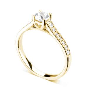 Resplendissante : Bague diamant en or jaune 18k à griffes en treillis et épaules pavées. Épaules serties double-grains 14 diamants G/VS total 0.20 carats.