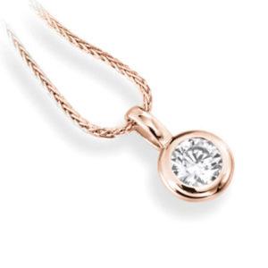 Subtil : Pendentif diamant en or rose 18k serti clos, chaîne en or incluse. Production et livraison en 10 à 5 jours ouvrés.